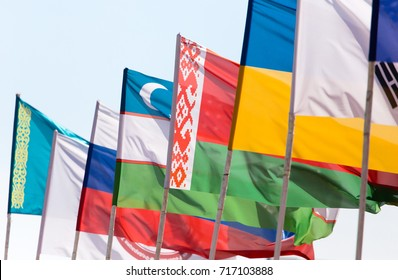 flags of different countries against the blue sky