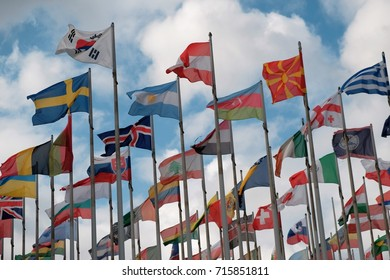 Flags from different countries around the world fluttering