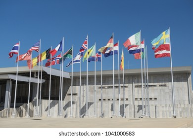 Flags of different countries in front of the famous meeting hall in Chonburi province,Thailand.February-2018.