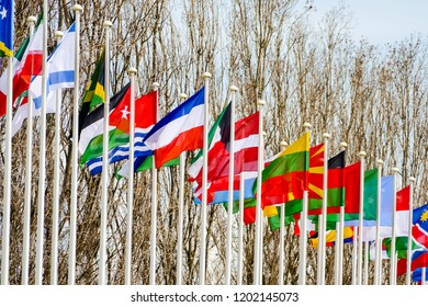 flags of different countries on background of blue sky, in Lisbon Capital City of Portugal