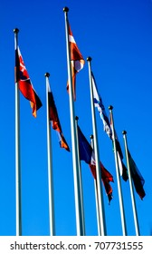 Flags of different countries on the background of blue sky