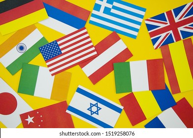 Flags of different countries on yellow background