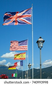 Flags of different european countries against blue sky