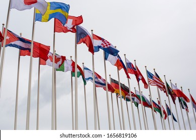 flags of different states against the sky