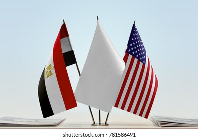 Flags of Egypt and USA with a white flag in the middle