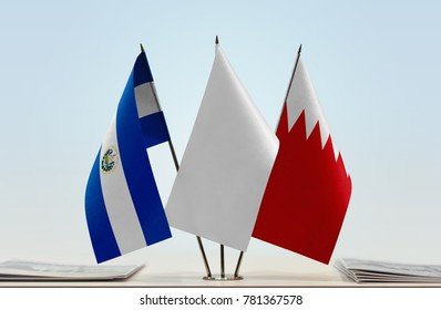 Flags of El Salvador and Bahrain with a white flag in the middle