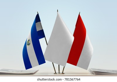 Flags of El Salvador and Indonesia with a white flag in the middle
