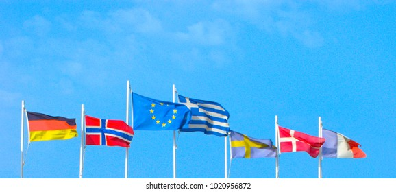 Flags of EU, Greece, Germany, Norway, Sweden, Denmark, France isolated on blue sky. Concepts of politics, tourism, economy, cooperation, eurozone and other.