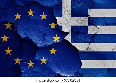 flags of EU and Greece painted on cracked wall