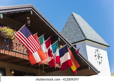 Flags of European and North American countries hanging off of balcony in Vail, Colorado