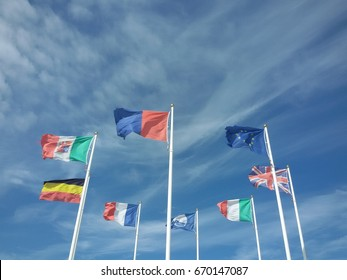 Flags of European states moved by a strong wind