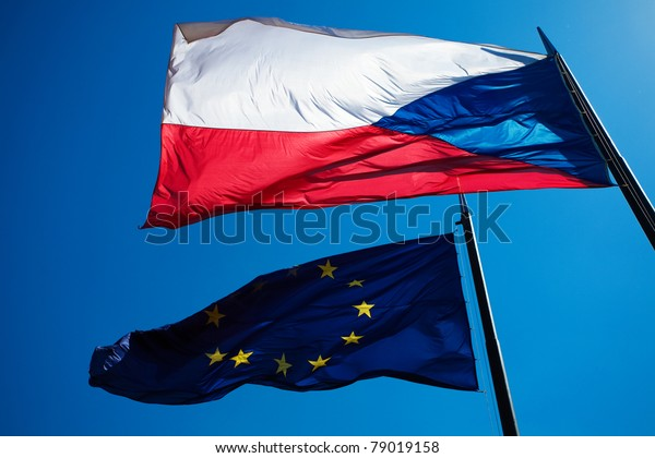 Flags of the European Union and the Czech Republic against the blue sky