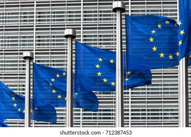 Flags of the European Union in front of the Berlaymont building in Brussels, Belgium.
