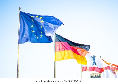 Flags of European Union and Germany at Berlin Tegel Airport, Berlin flag in background