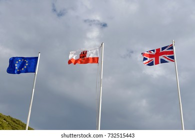Flags of the European Union, Gibraltar and United Kingdom against the sky.