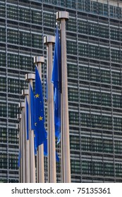 Flags of the European Union are hanging besides the headquarters of the European Commission in Brussels, Belgium.