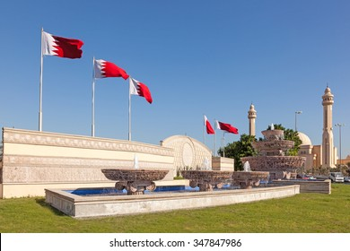 Flags and fountain in the city of Manama, Kingdom fo Bahrain, Middle East