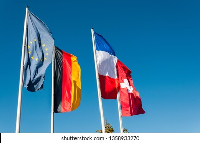 Flags in front of sky