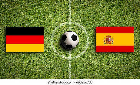 Flags of Germany and Spain on a soccer field