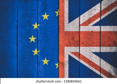 Flags of Great Britain and Europe on a wooden background. Brexit decision