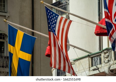Flags of Great Britain, USA and Sweden on the facade of the hotel