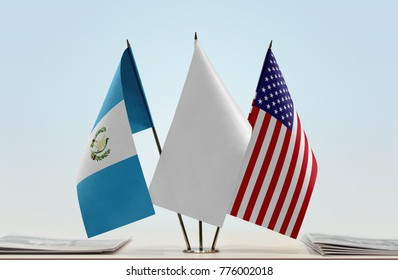 Flags of Guatemala and USA with a white flag in the middle