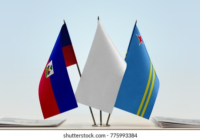 Flags of Haiti and Aruba with a white flag in the middle