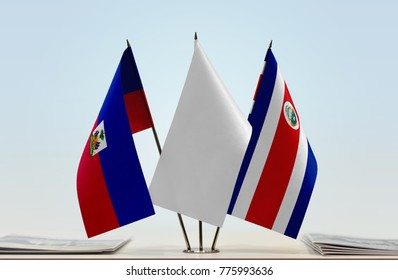 Flags of Haiti and Costa Rica with a white flag in the middle