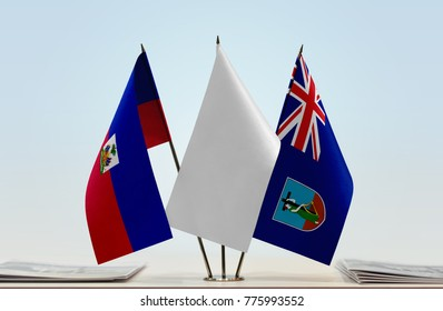 Flags of Haiti and Montserrat with a white flag in the middle