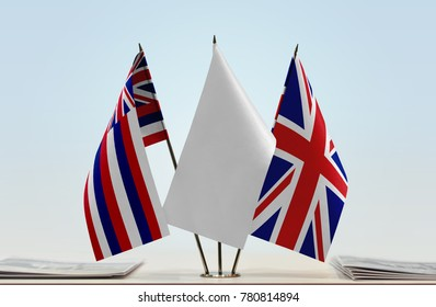 Flags of Hawaii and United Kingdom with a white flag in the middle