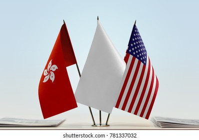 Flags of Hong Kong and USA with a white flag in the middle