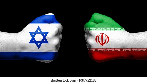Flags of Israel and Iran painted on two clenched fists facing each other on black background/Israel - Iran conflict concept