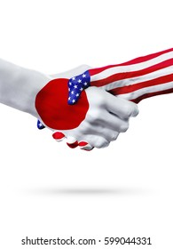 Flags Japan and United States countries, handshake cooperation, partnership and friendship or sports competition isolated on white