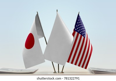Flags of Japan and USA with a white flag in the middle