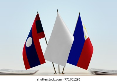 Flags of Laos and Philippines with a white flag in the middle