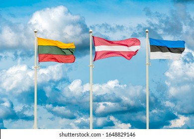 Flags of the Lithuania, Latvia and Estonia. Flags of the Baltic States waving on the sky background