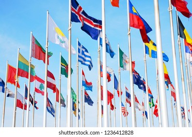 Flags of many countrys of the world in waving in the sky