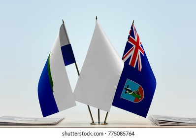 Flags of Navassa Island and Montserrat with a white flag in the middle