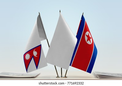 Flags of Nepal and North Korea with a white flag in the middle