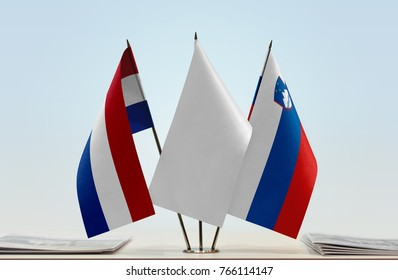 Flags of Netherlands and Slovenia with a white flag in the middle
