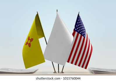 Flags of New Mexico and USA with a white flag in the middle
