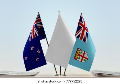 Flags of New Zealand and Fiji with a white flag in the middle