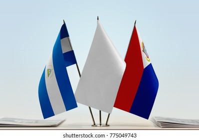Flags of Nicaragua and Sint Maarten with a white flag in the middle