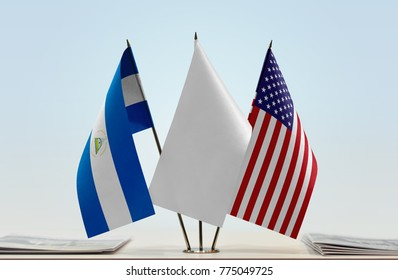 Flags of Nicaragua and USA with a white flag in the middle