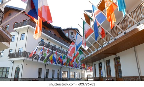 Flags in the Olympic village Roza Khutor. Russia, Sochi - July 14, 2015: Venue Winter Olympic Games 2014