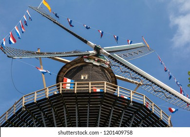 Flags on Dutch windmill at King's Day