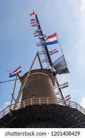Flags on Dutch windmills at King's Day