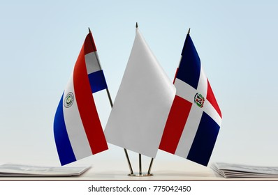 Flags of Paraguay and Dominican Republic with a white flag in the middle