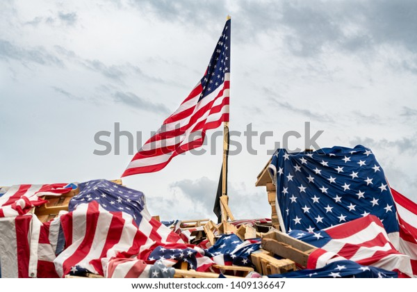 Flags Piled on Wood Before Being Retired in A Watch Fire.