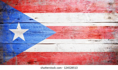 Flags of Puerto Rico painted on grungy wood plank background